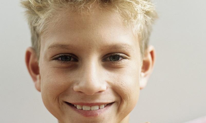 Boy (12-13) smiling,portrait,close-up